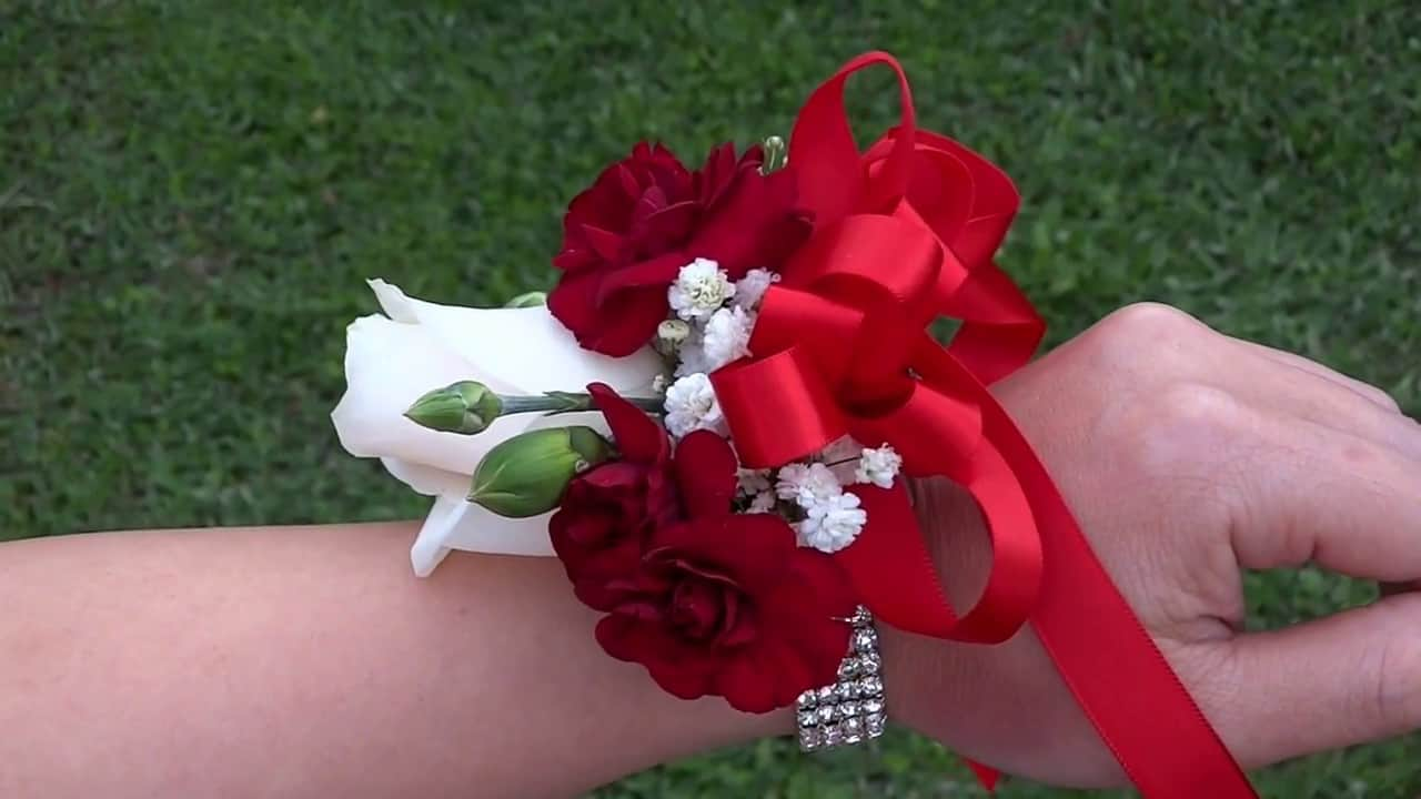 Red ribbon corsage