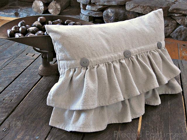 Buttoned half ruffle pillow
