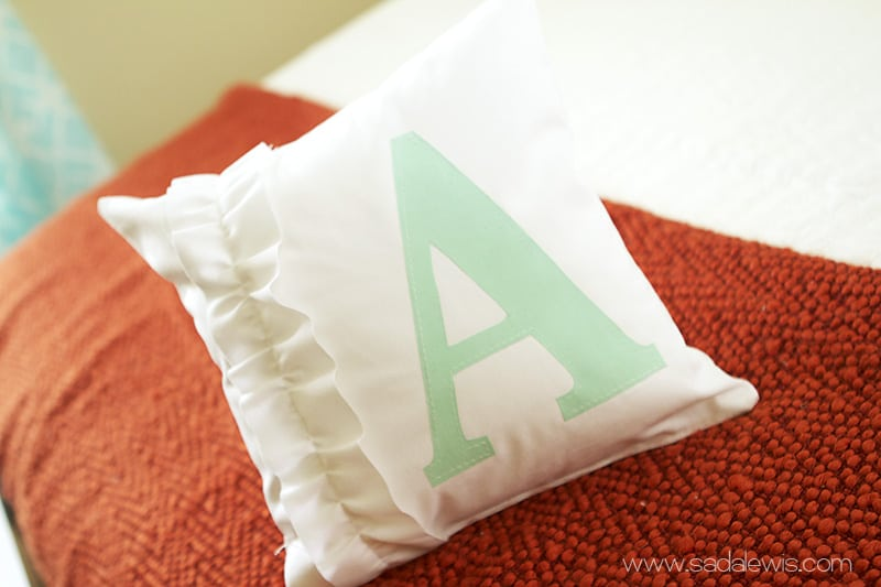 Painted monogram pillow