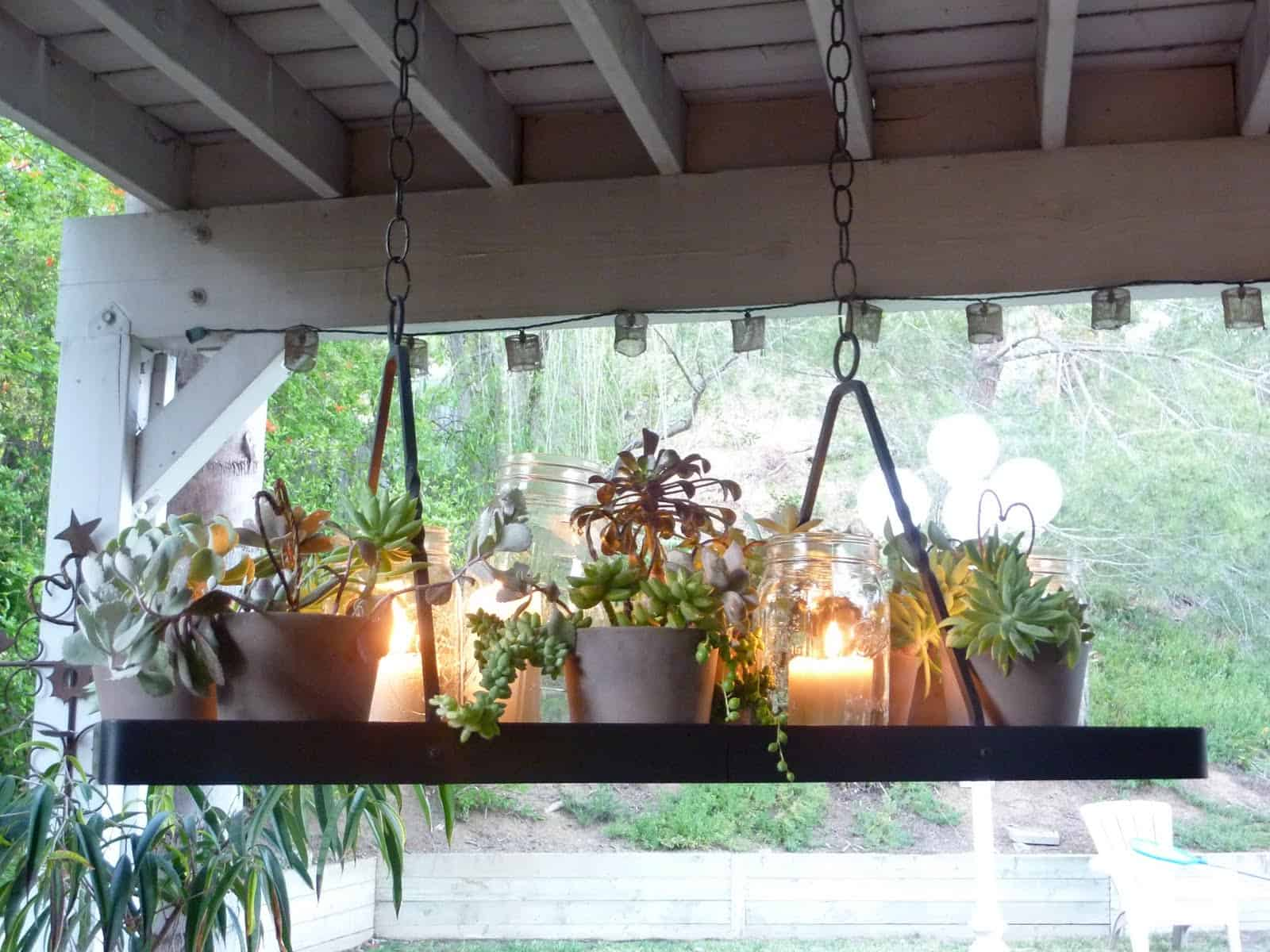 Homemade sparkle 12 awesome diy garden light ideas 12 hanging succulent and candle chandelier aloadofball Gallery