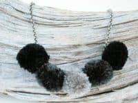 Anthrpologie inspired gray scale pom pom necklace 200x150 Colorful and Funky: 15 Super Fun DIY Pom Pom Jewelry