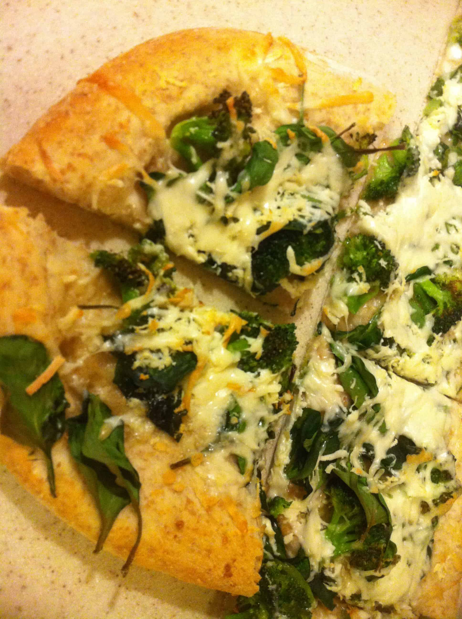 Homemade spinach, broccoli, and goat cheese pizza