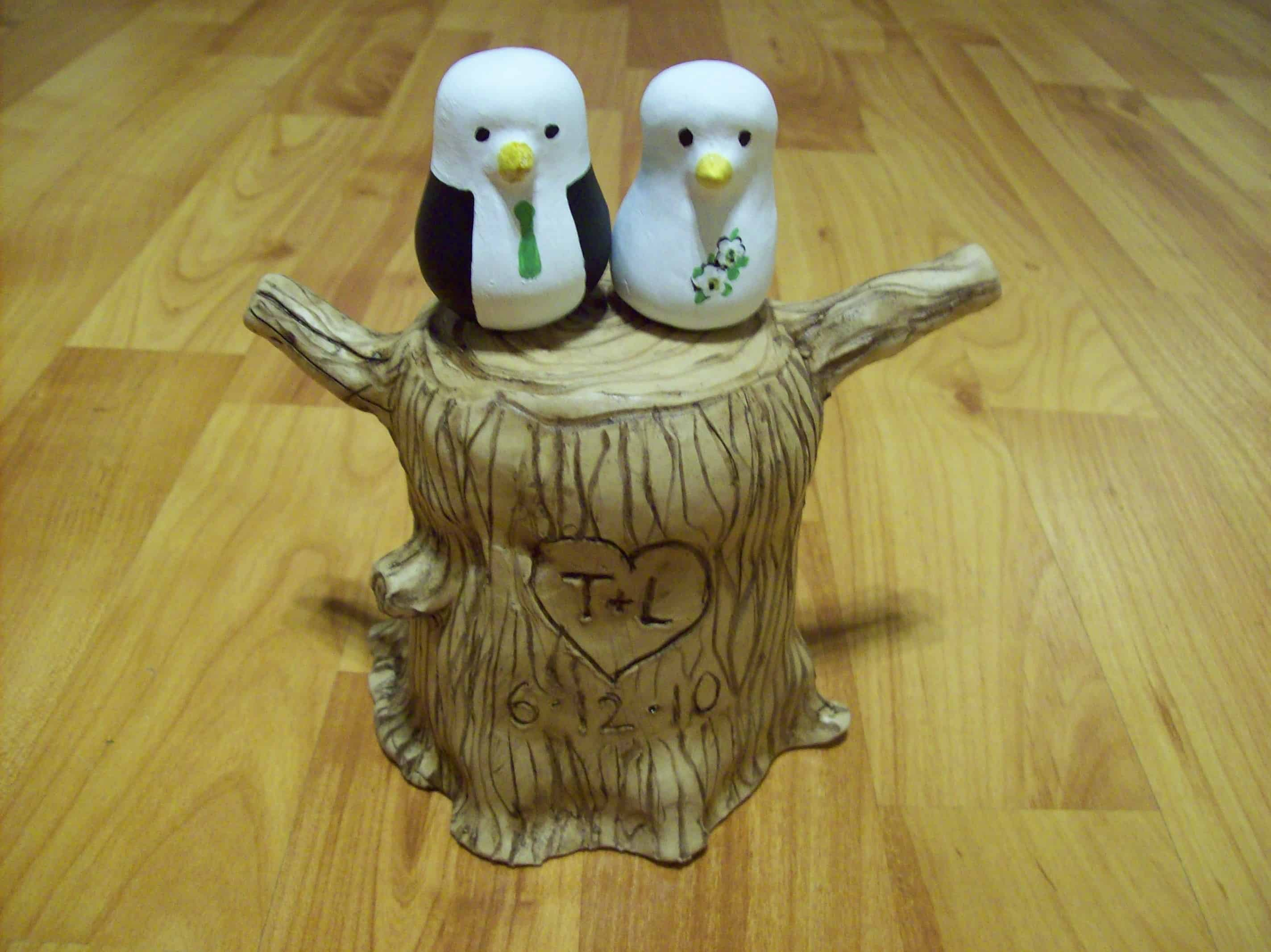 Love birds on on a carved tree