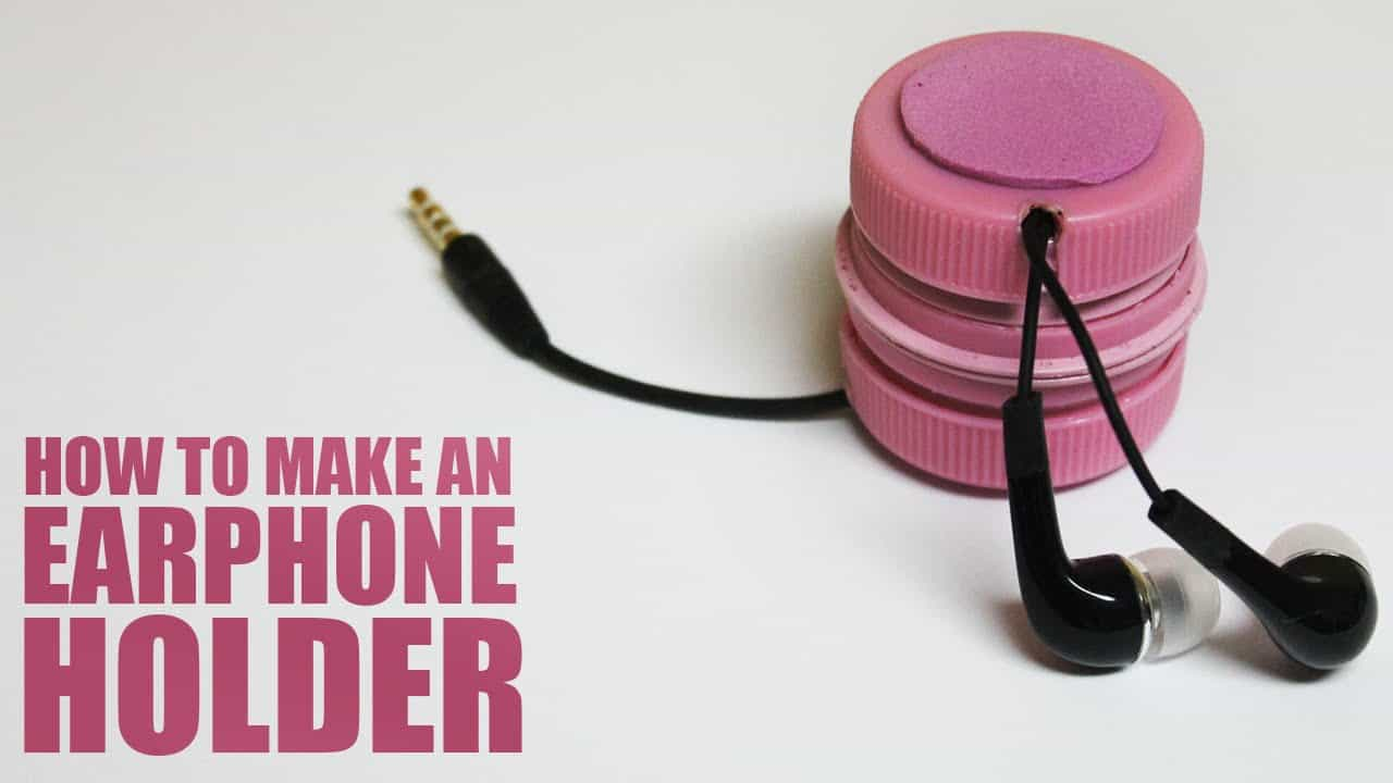 Upcycled bottle earphone holder