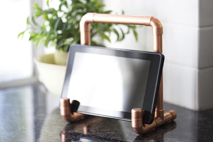 Copper pipe tablet holder