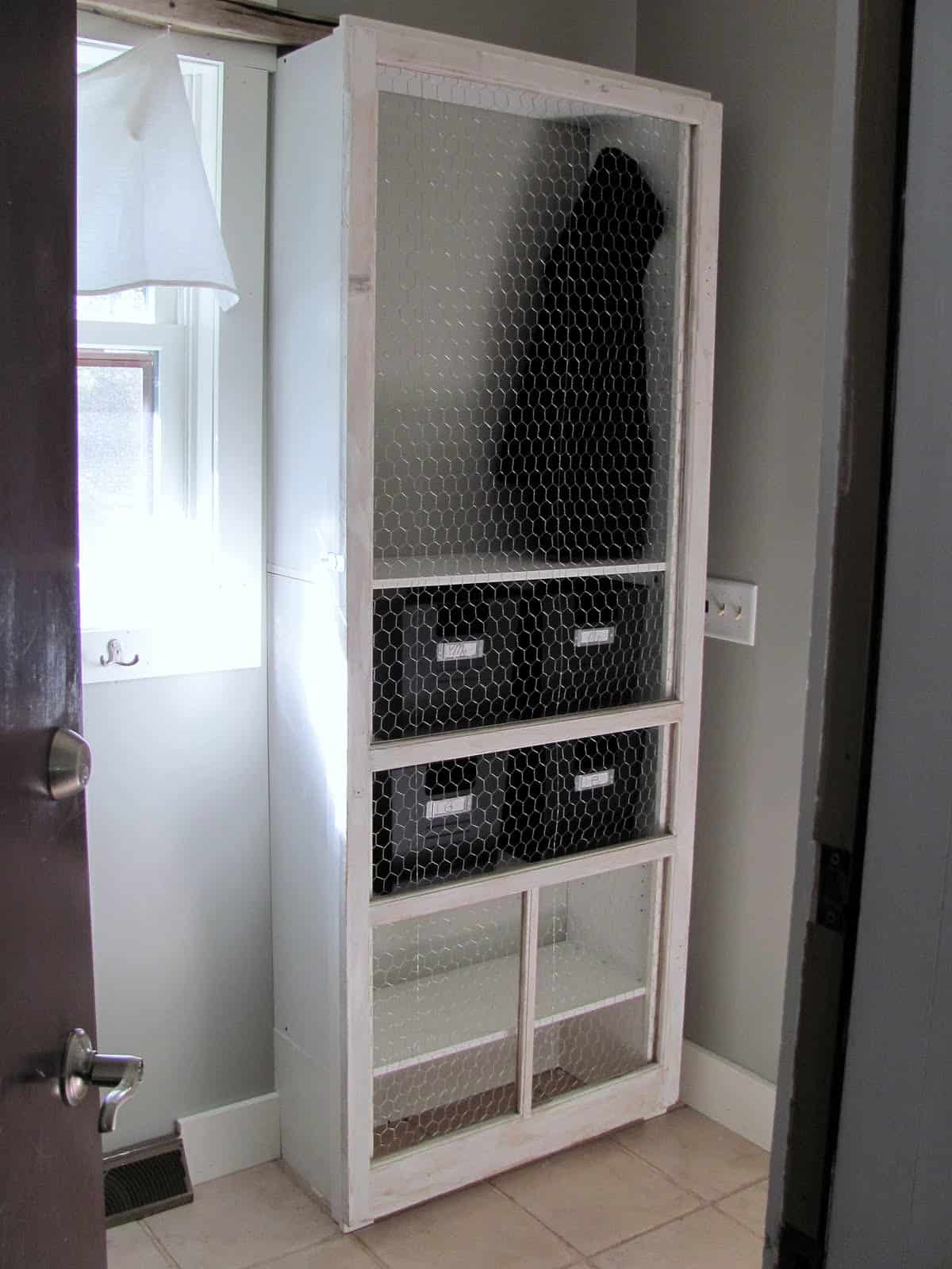 Screen wire laundry room cabinet