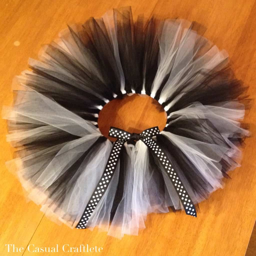 Black and white striped no-sew tutu with a polka dotted bow