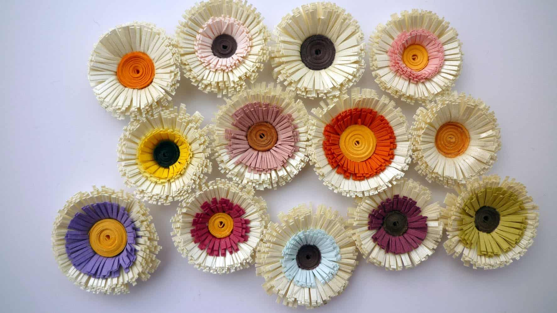 Cut, layered, and quilled flowers