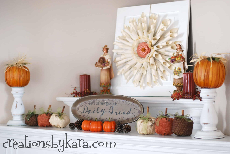 Fabric pumpkins ad pine cones