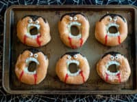 Fanged vampire donuts 200x150 15 Kid Friendly Vampire DIY Projects for a Fun Filled Halloween