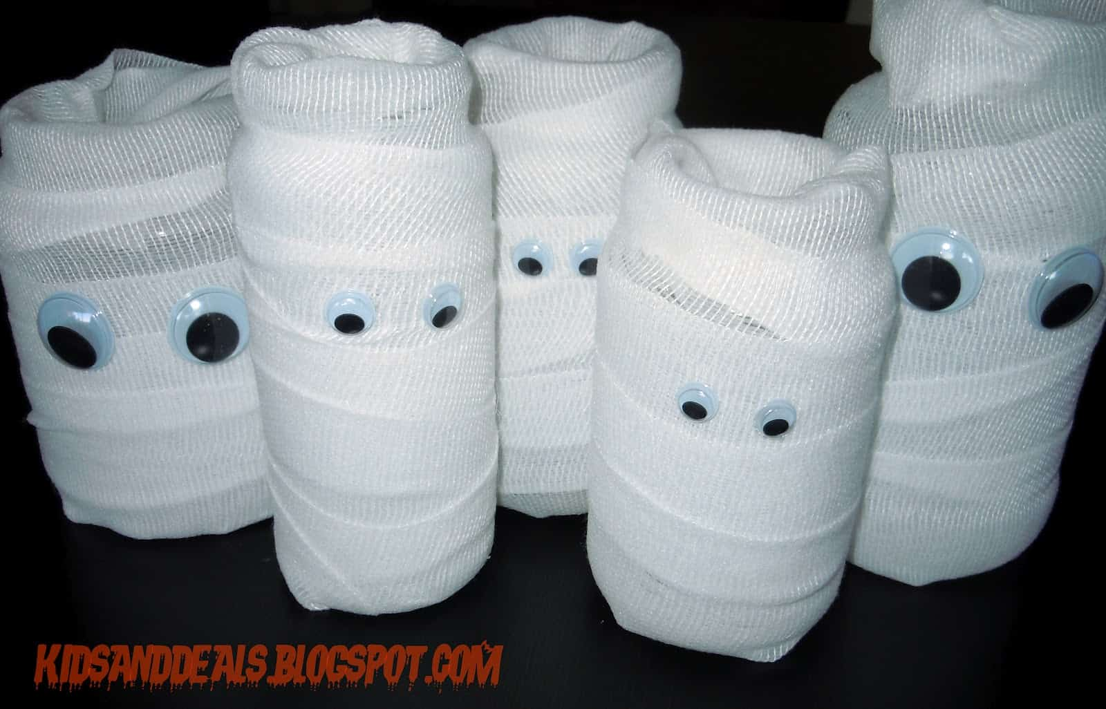 Gauze wrapped toilet paper roll mummies