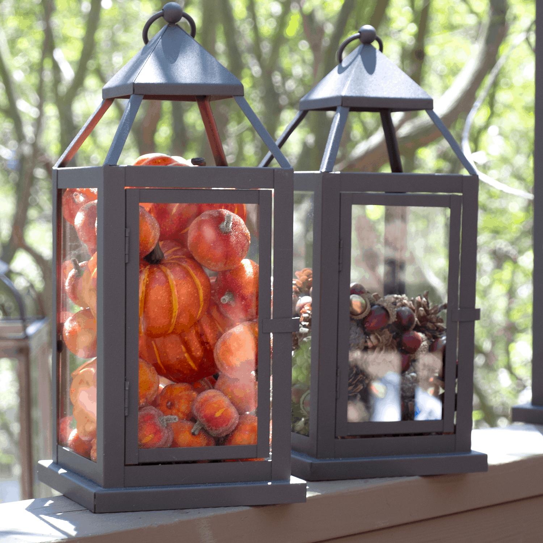 Pumpkin and acorn filled lanterns