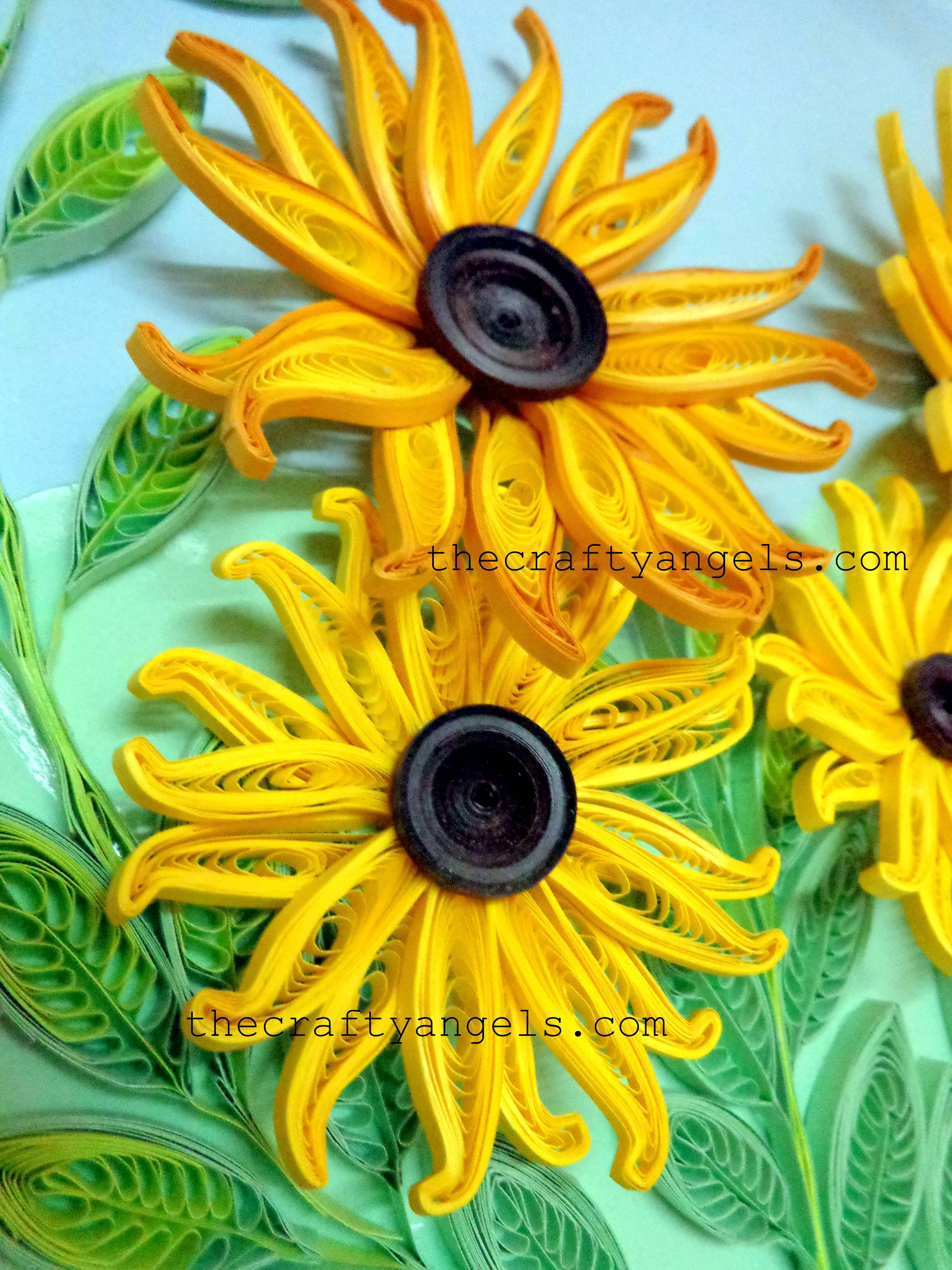 Quilled sunflowers with button middles