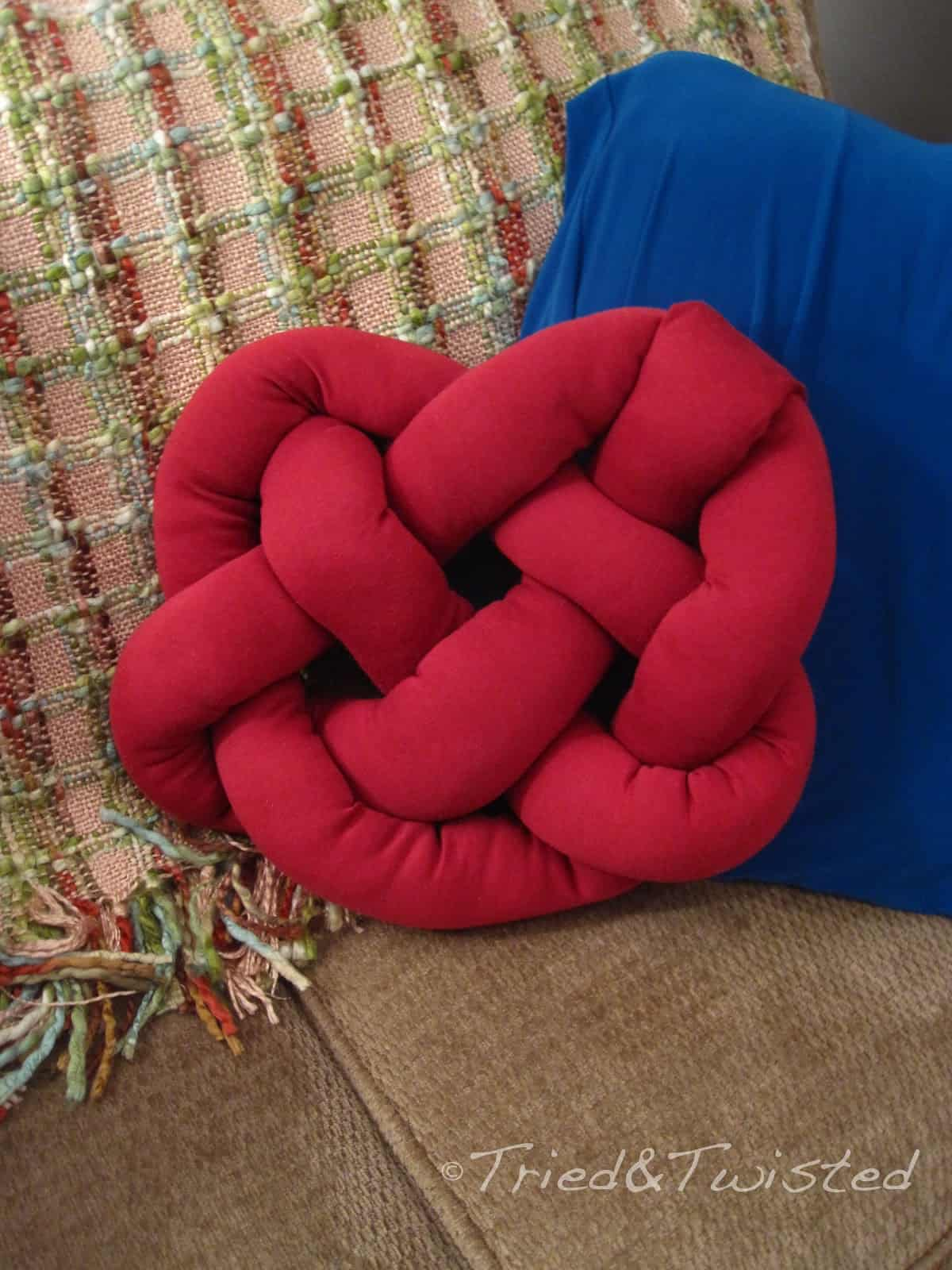 Red heart knot pillow