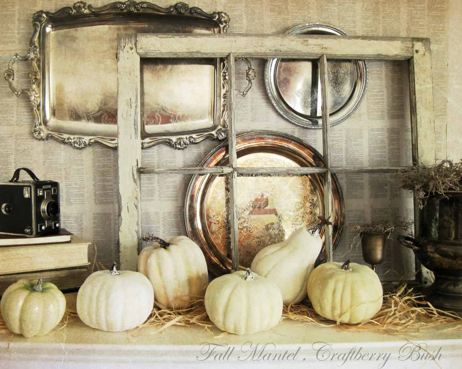 Vintage trays, rustic windows, and white pumpkins