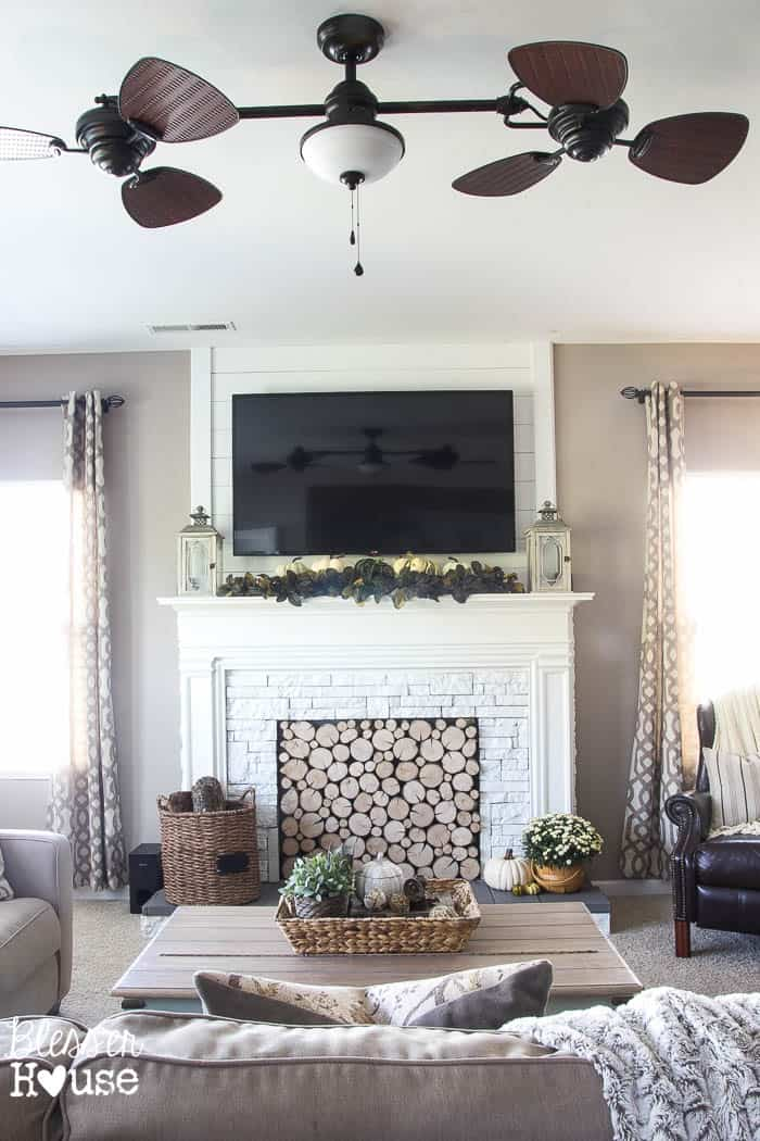 Faux log fireplace entertainment center