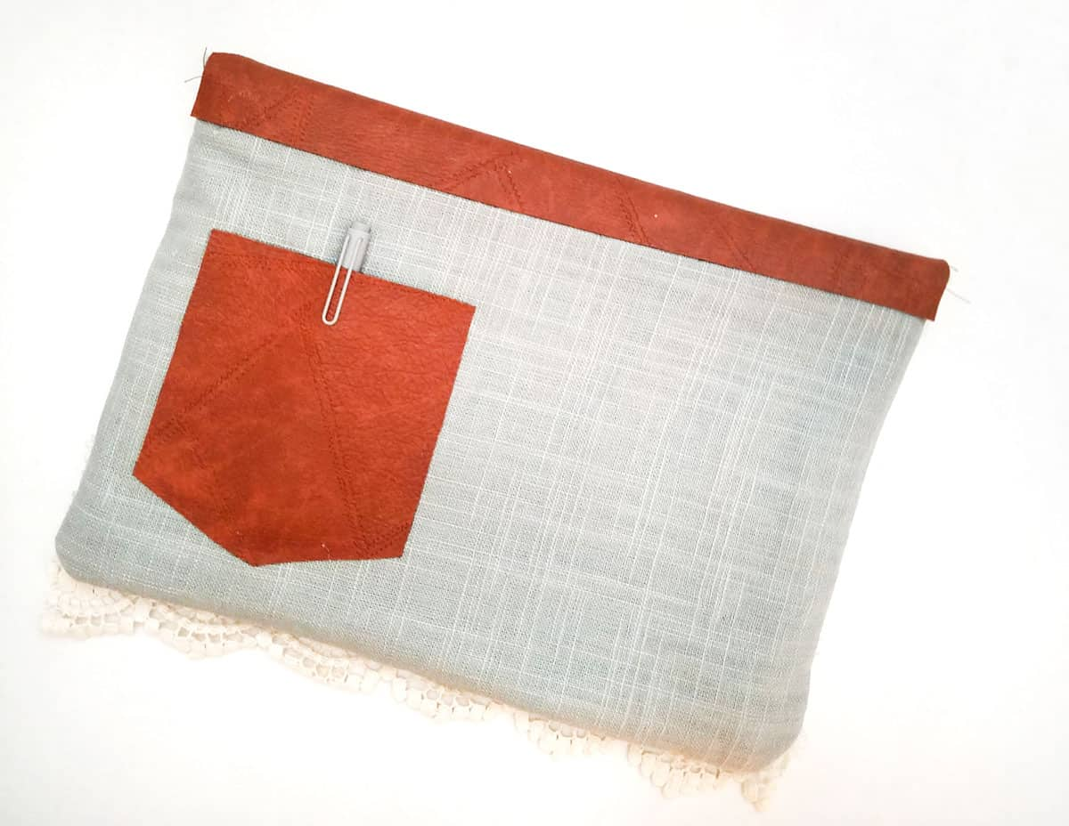 Multi-fabric case with a pocket