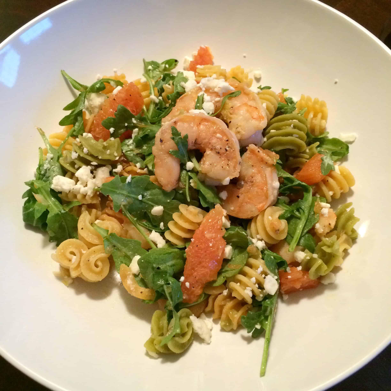 Pasta with shrimp, orange, and arugula