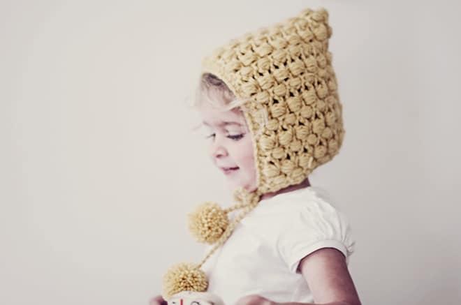 Pom pom ear flap hat