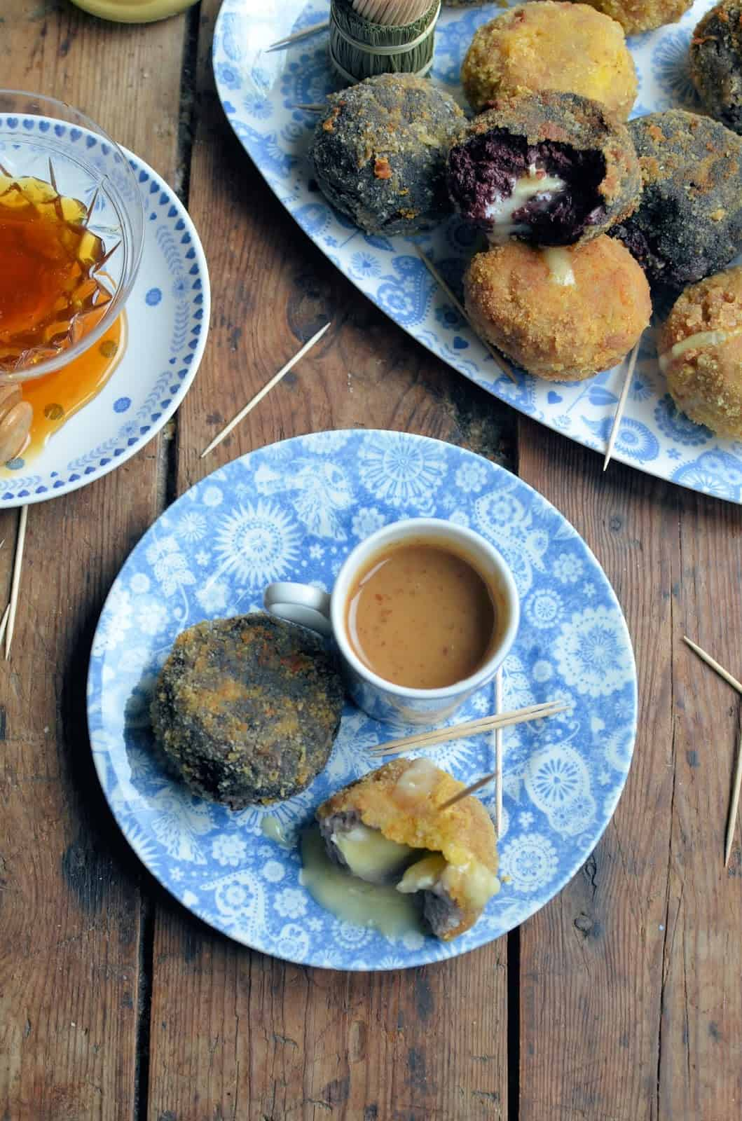 Rustic camembert Scotch eggs with mustard and honey dip