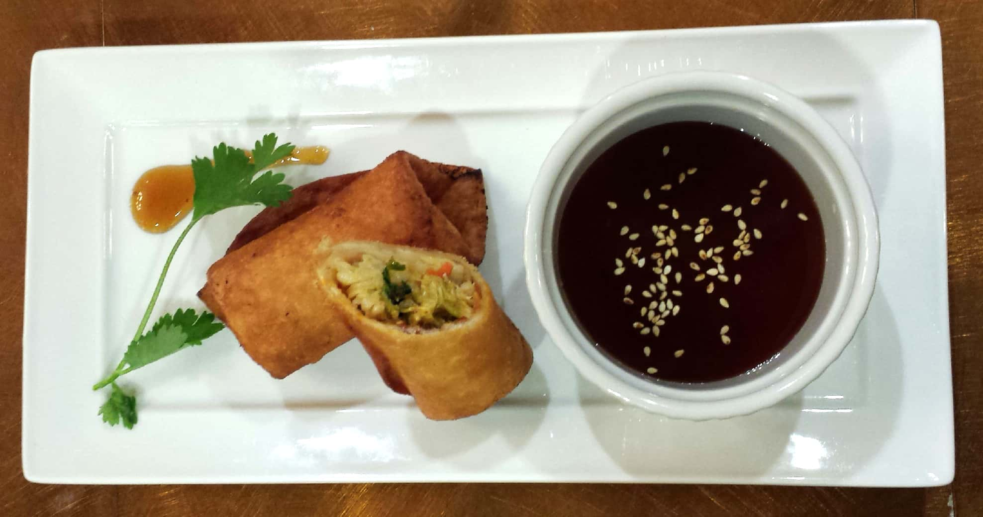 Spicy crab coconut spring rolls with sweet and sour dipping sauce
