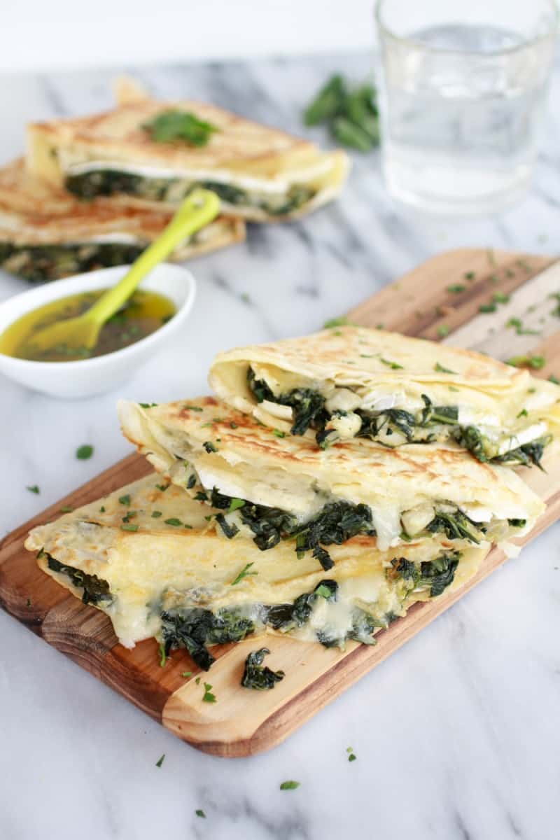 Spinach, artichoke, and brie crepes with sweet honey sauce