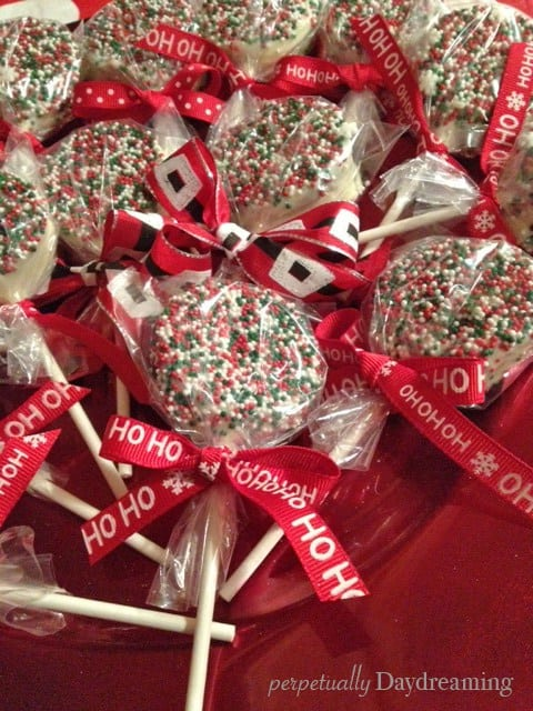 Chocolate covered Oreo pops with Christmas sprinkles