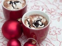 Creamy hot chocolate with whipped cream and chocolate 200x150 15 Deliciously Unique Hot Chocolate Recipes for the Holidays