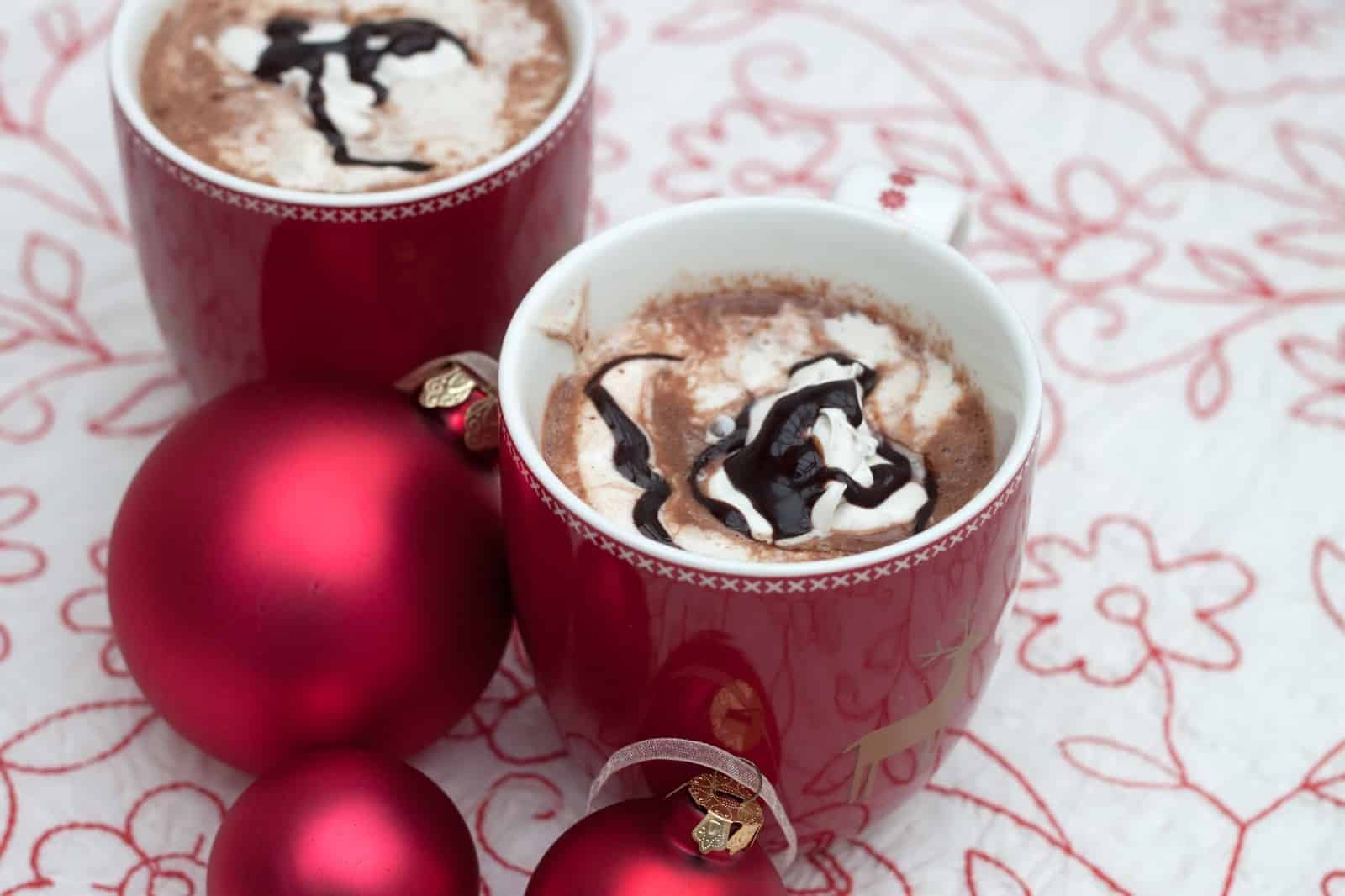 Creamy hot chocolate with whipped cream and chocolate