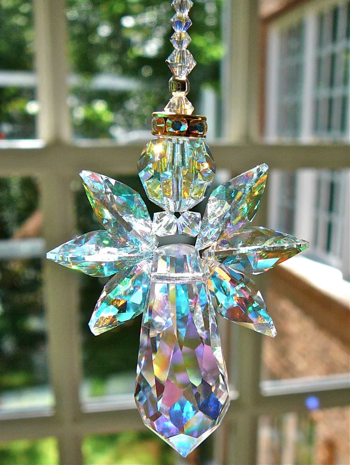 Crystal bead angel suncatcher 15 DIY Christmas Window Hangers that Are Cute