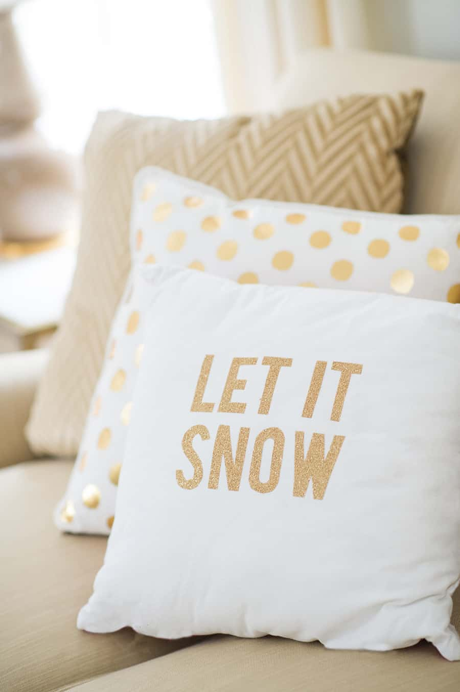 Gold and white Christmas pillows