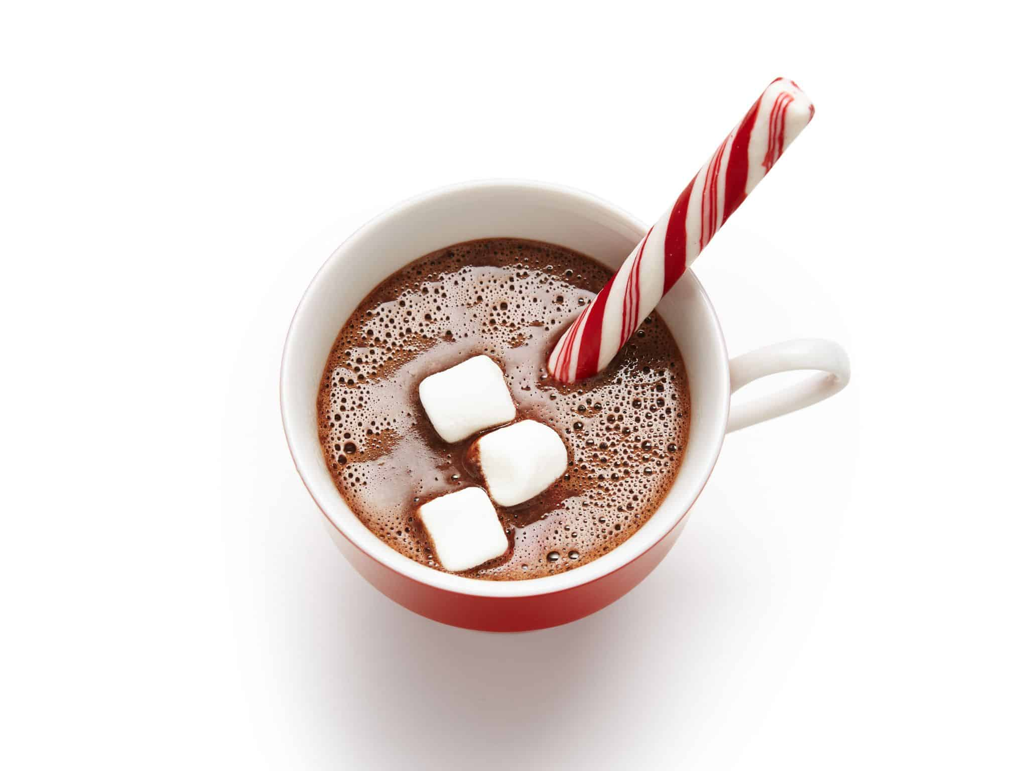 Hot chocolate with marshmallows and a candy cane stir stick