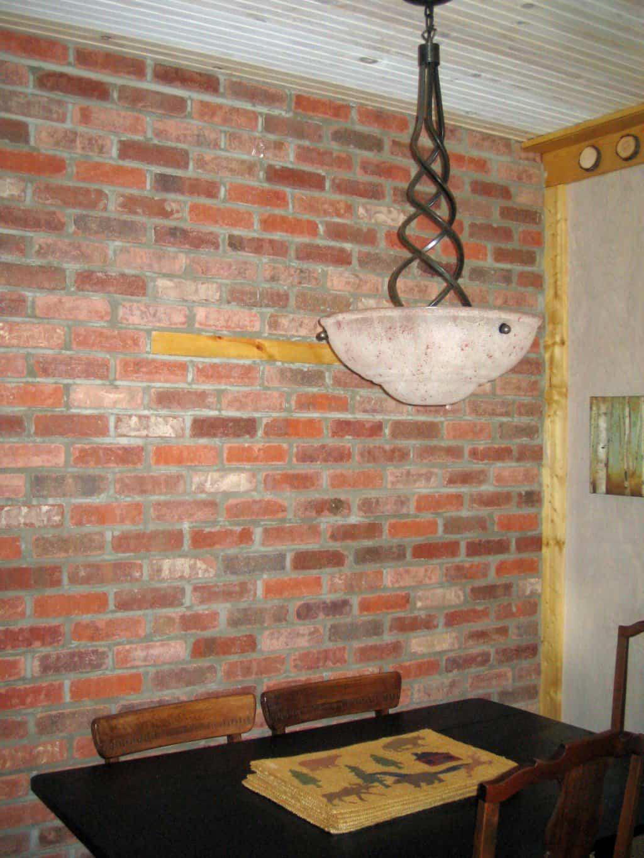 Brick dining room wall