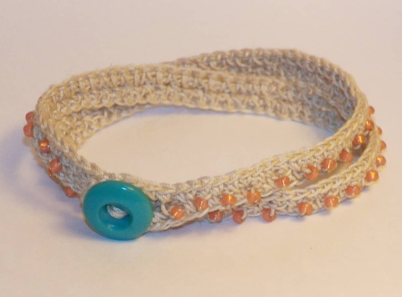 Crocheted beaded wrap bracelet with a button
