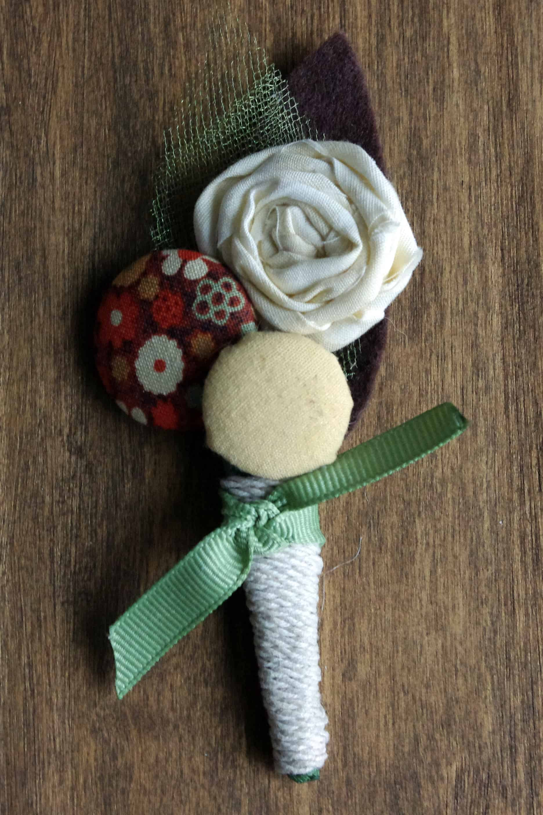 Fabric covered buttons and material wrapped roses
