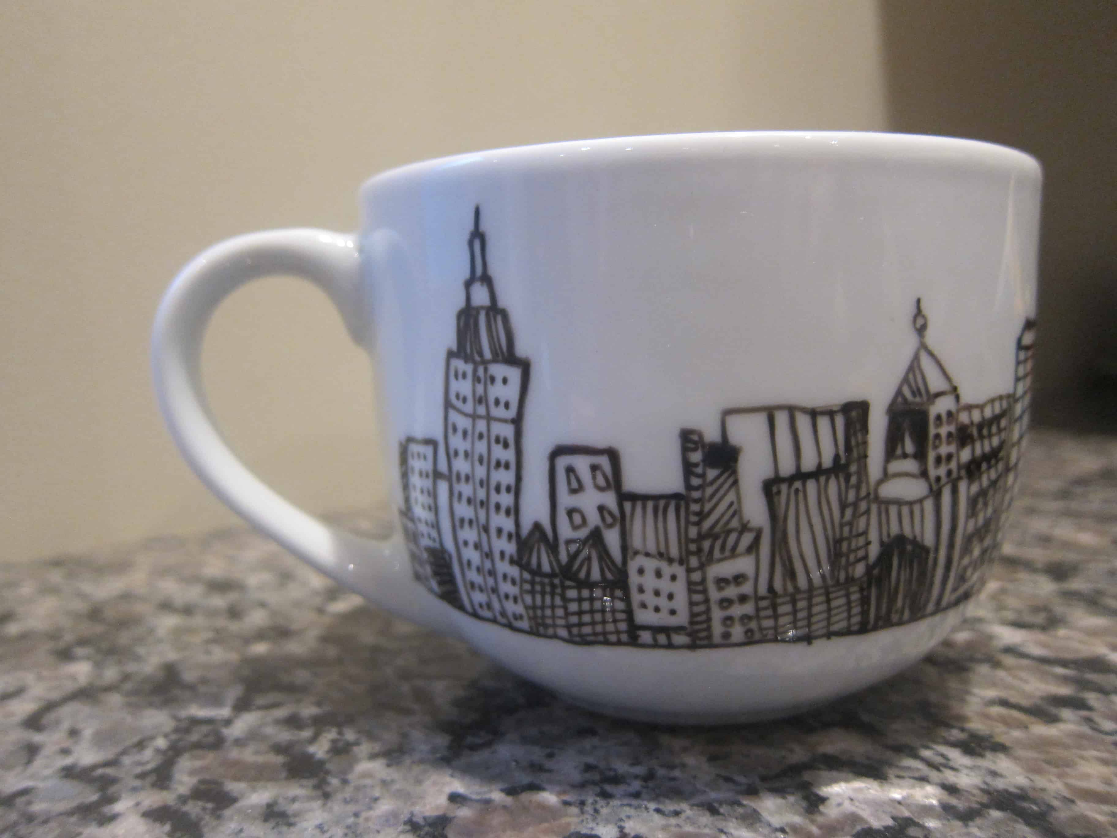 Paint pen sketches on mugs