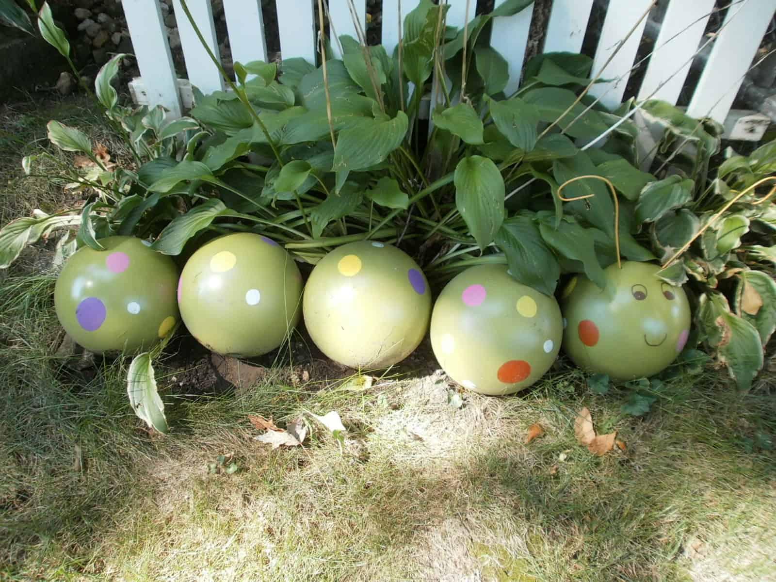 Painted bowling ball garden caterpillar