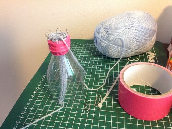 Paper clip and drink bottle spool knitter