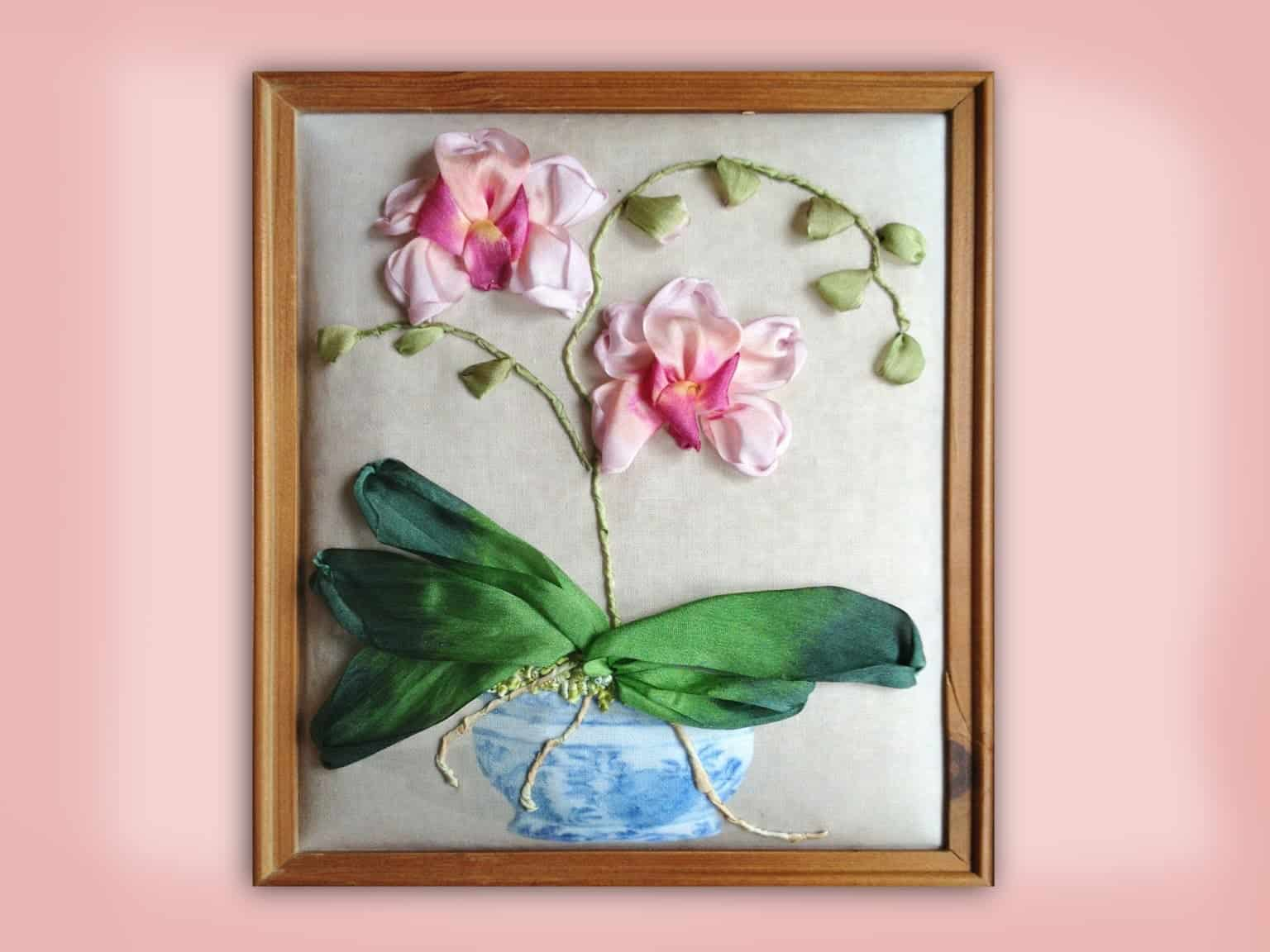 Plush backed and painted ribbon embroidery with a frame