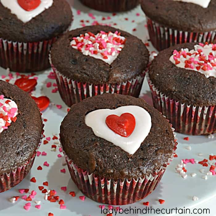Iced cutout cupcakes 15 Delicious Valentine's Day Cupcake Ideas