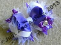 Multi ribbon bow with feathers and mini bows 200x150 15 Cute and Fancy Hair Bow Designs