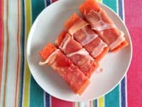Prosciutto wrapped watermelon chunks 200x150 Tasty and Healthy: 15 DIY Watermelon Recipes