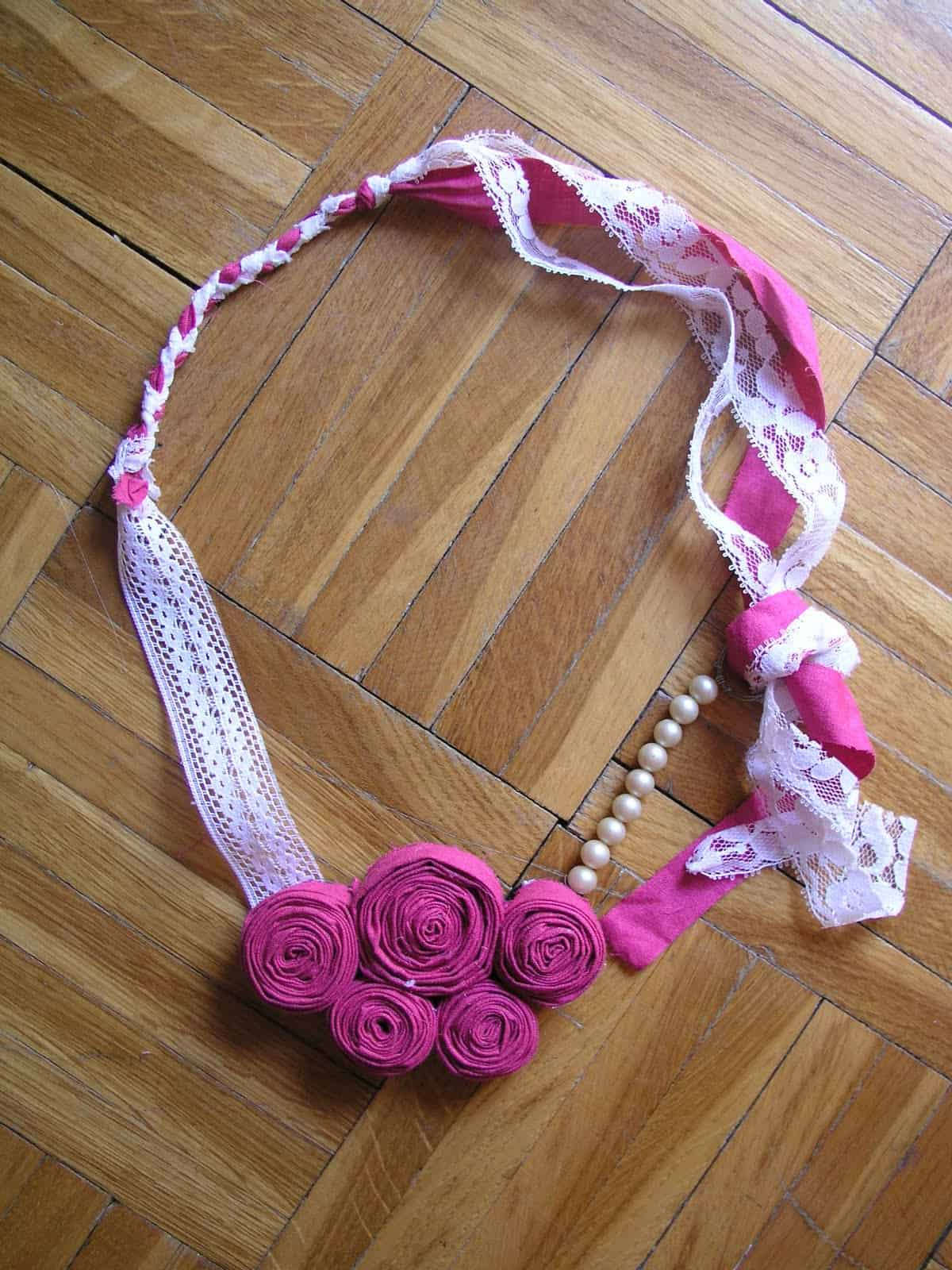 Spiralled blossom lace and fabric necklace