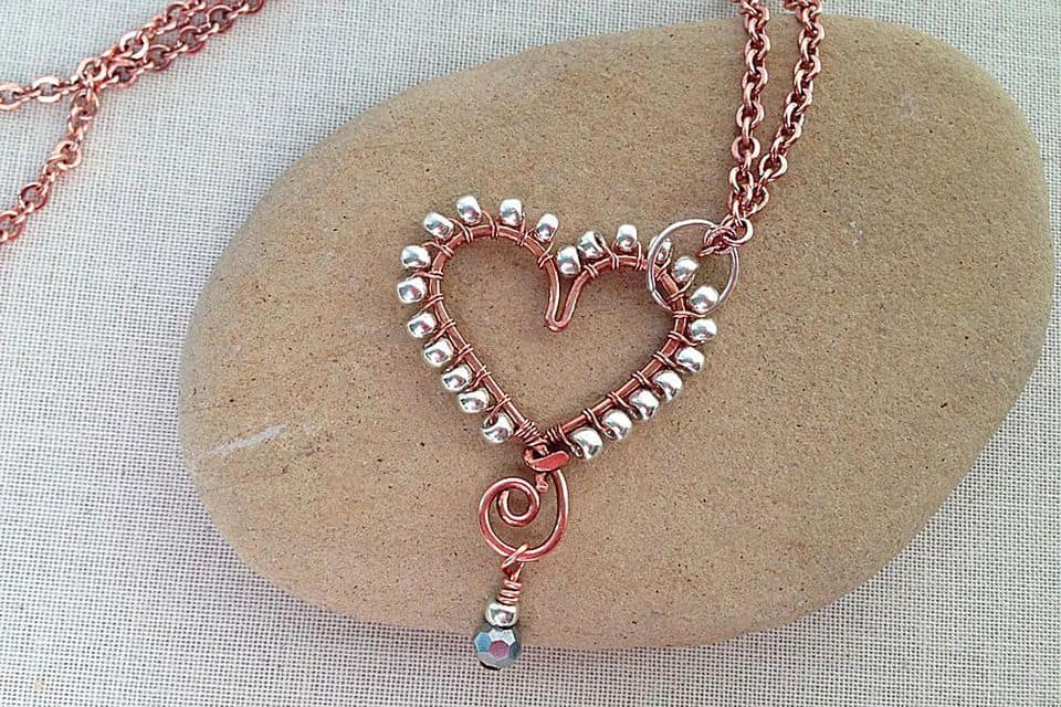 Wire wrapped bead border heart pendant