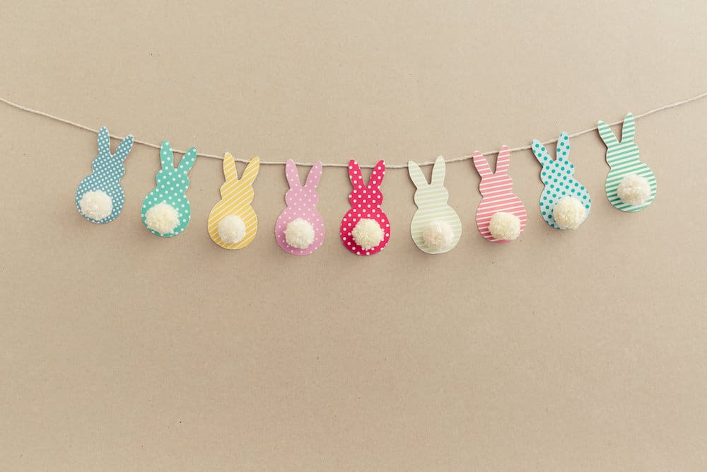 Easter Bunny Banner. Cute bunny shapes with yarn pom pom tails.