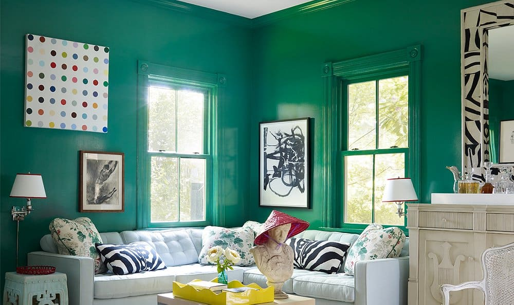 Emerald green and teal walls with light furniture