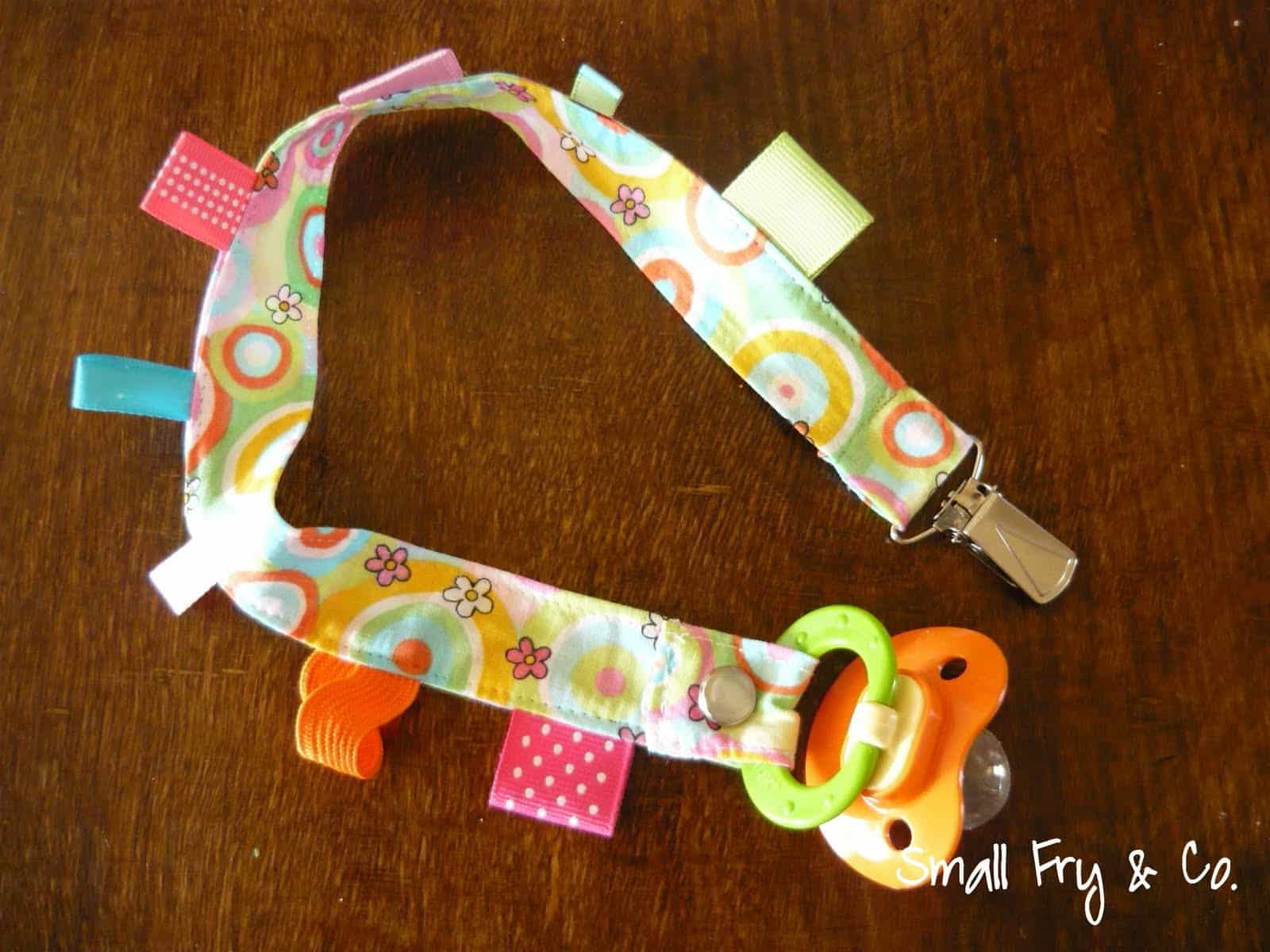 Pacifier clip with tags