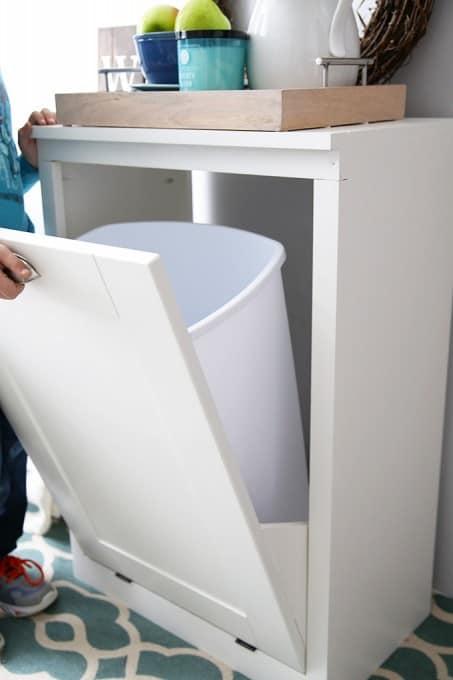 White tilt out trash cabinet