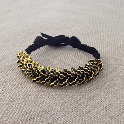 Gold and suede braided bracelet