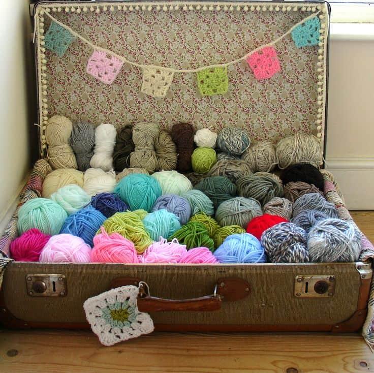 Vintage suitcase scrap yarn pile